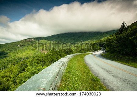 Blue Ridge Parkway in Western North Carolina under storm clouds.