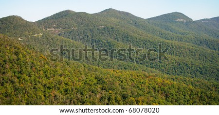 Blue Ridge Parkway road on the side of mountains - stock photo