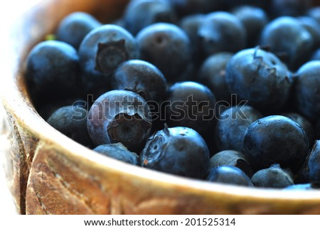 Blue ripe fresh blueberries in a beautiful bowl.