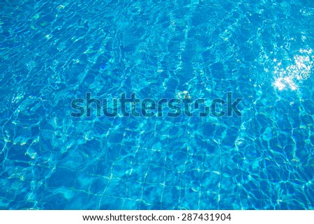 Blue ripped water in swimming pool - stock photo