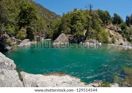 Blue river in a stone canyon. Cajon Del Azul, El Bolson, Argentina - stock photo