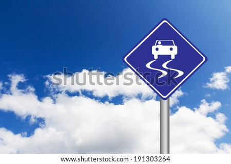 Blue road signs with slippery road sign icon on blue sky background - stock photo