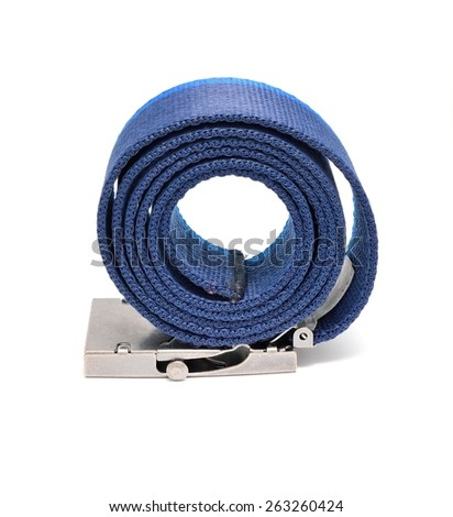 Blue rolled belt placed on a white background. Belt is made from polyester and it has metal buckle and two shades of blue color. - stock photo