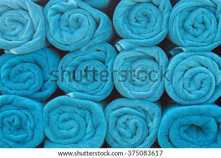 Blue rolled towels.