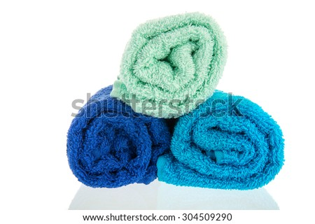 Blue rolled towels isolated over white background - stock photo