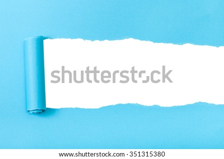 blue rolled-up torn paper on white isolated background - stock photo
