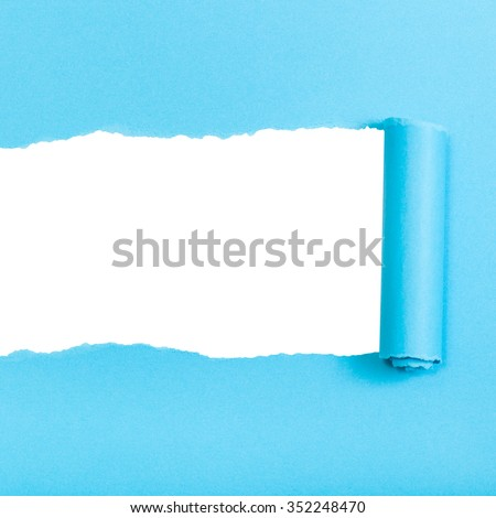 blue rolled-up torn paper on white isolated square background - stock photo