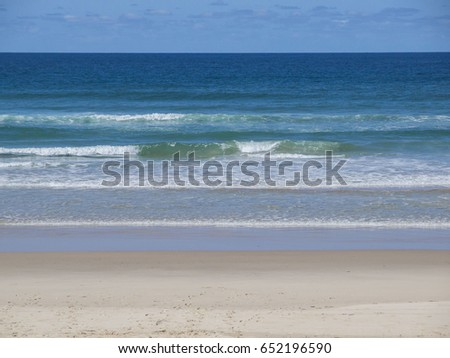 Blue rolling waves of a Gold Coast beach in Queensland, Australia