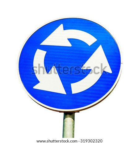 Blue roundabout crossroad road traffic sign isolated on white - stock photo