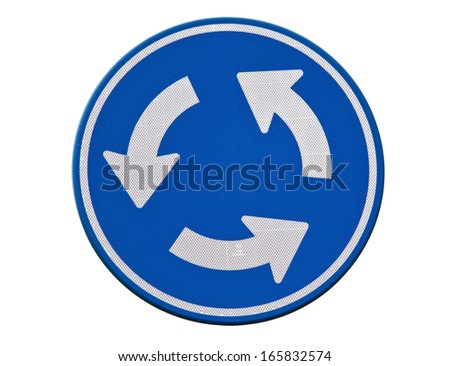 Blue roundabout traffic sign - stock photo
