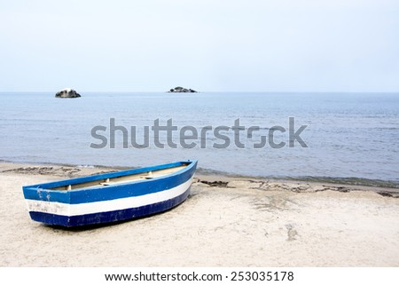 Blue Rowing Boat on the Beach of Lake Malawi, Malawi, Africa - stock photo