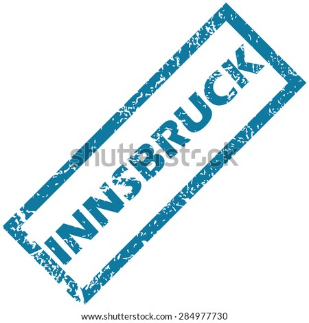 Blue rubber stamp with city name Innsbruck, isolated on white