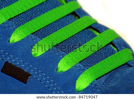 Blue runner with green laces