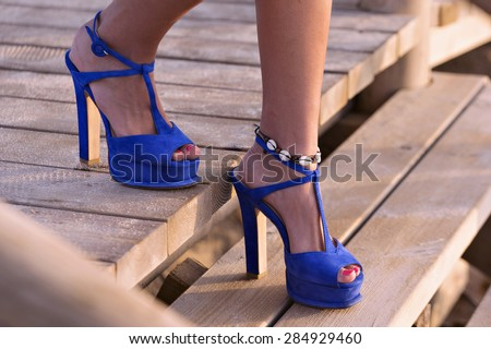 Blue sandals with high heels  - stock photo