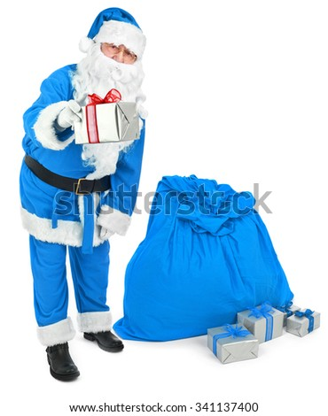 Blue Santa claus gives a present  - stock photo