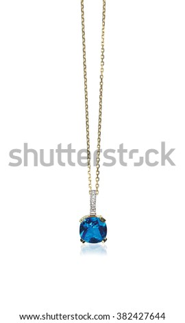 Blue sapphire gemstone birthstone necklace with diamonds isolated on white. Cushion cut stone - stock photo