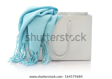 Blue scarf in shopping bag isolated on a white background - stock photo