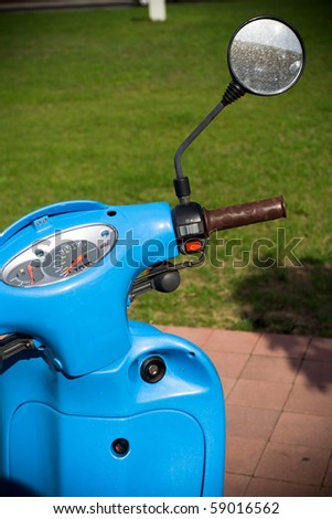 Blue scooter on parking lot, ecology and transport - stock photo