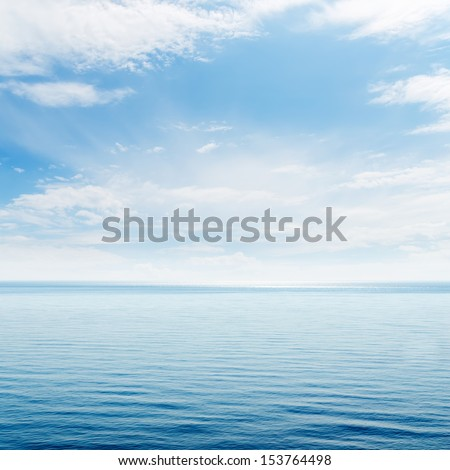 blue sea and clouds in sky - stock photo