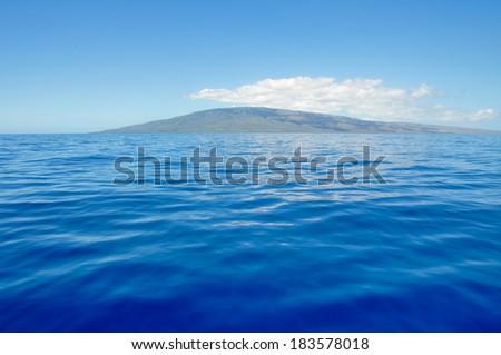Blue sea and island of Lanai, Maui (USA) - stock photo
