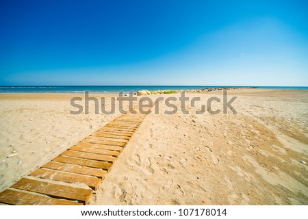 Blue sea and sand - stock photo