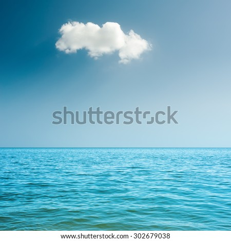 blue sea and white clouds on sky - stock photo
