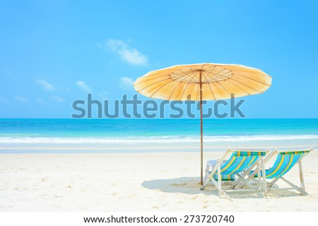 Blue sea and white sand beach with beach chairs and parasol, Samed island, Thailand - holiday and vocation concepts - stock photo