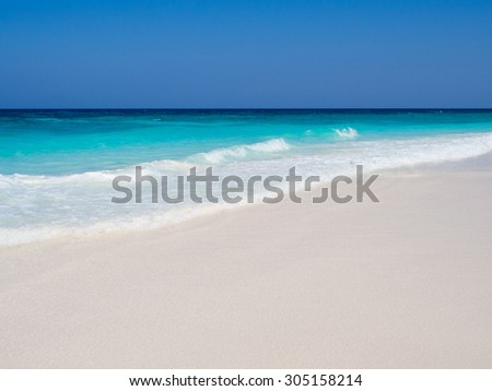 Blue Sea and White Sand in Sunny Day