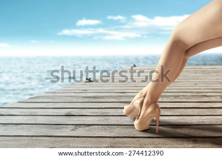 blue sea and woman legs