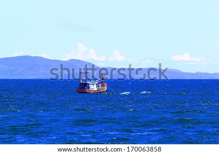 Blue sea boat hulls - stock photo