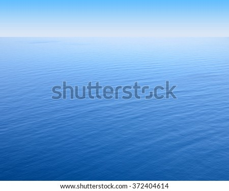 blue sea levels overlooking the horizon - stock photo