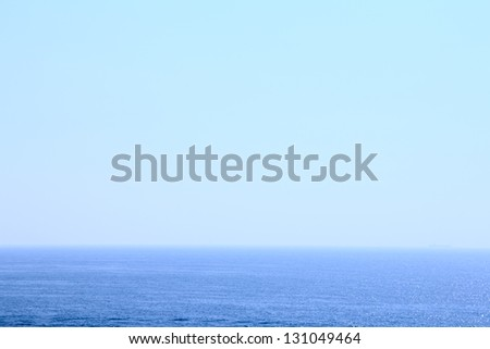 Blue sea under transparent clear sky - stock photo