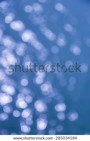 Blue sea water bokeh background nature