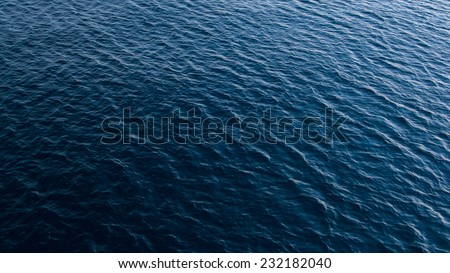 Blue sea water in calm - stock photo
