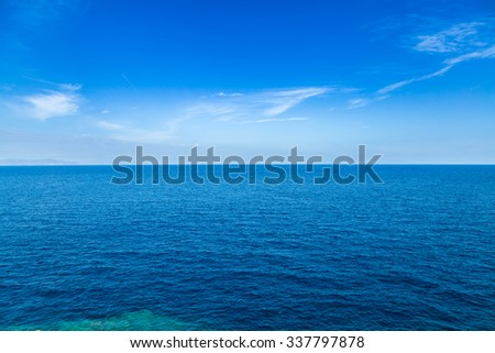Blue sea waters and clear blue sky horizon - stock photo
