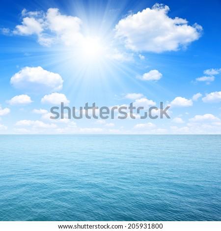 Blue sea with sunny sky - stock photo