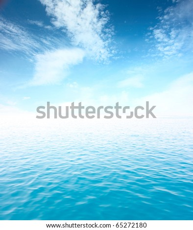 Blue sea with waves and sky with clouds - stock photo