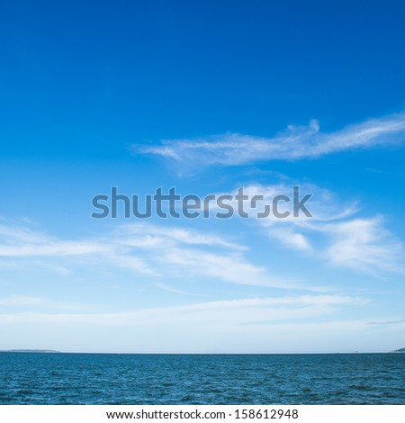 Blue sea with white clouds for background. - stock photo