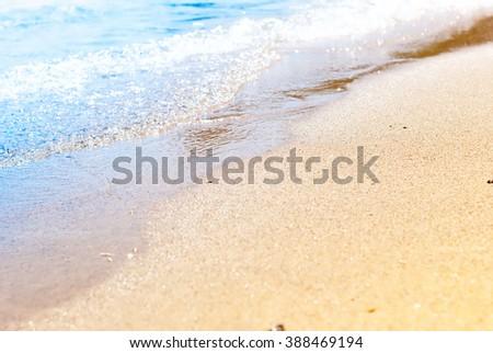 Blue Sea Yellow Sand Wave Beach Coast Line Holiday Background - stock photo