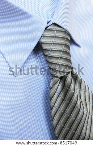 Blue shirt and a striped neck tie