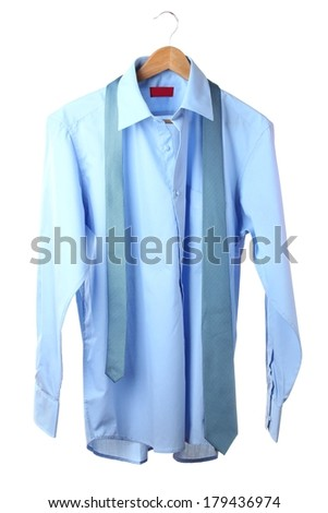 Blue shirt and tie on wooden hanger isolated on white - stock photo