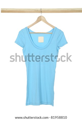 blue shirt hanging on wooden hangers