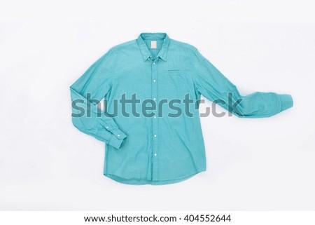 Blue shirt on hanger isolated  - stock photo