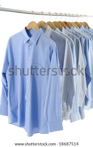 blue shirts on hangers - stock photo