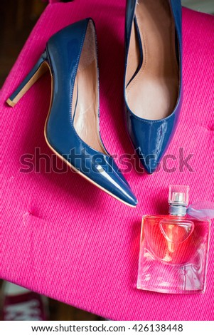 blue shoes and bottle perfume - stock photo