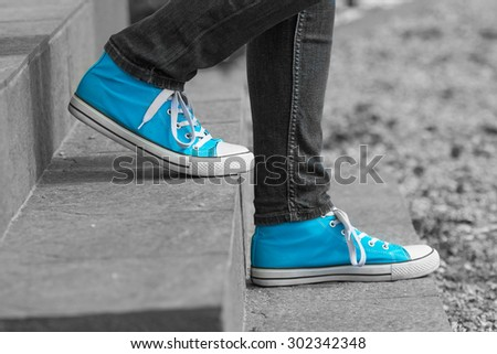 Blue shoes stone stairs take steps in Finland. Image includes a effect. - stock photo
