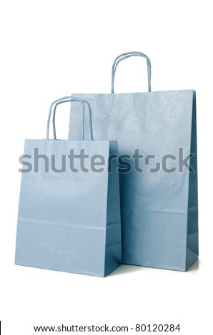 Blue shopping paper bags on white background. - stock photo