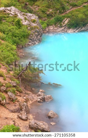 Blue shore of Sorapis lake, Dolomite Alps, Italy