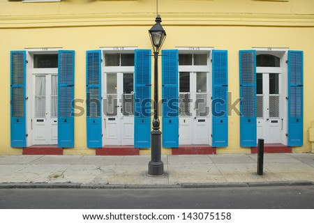 Blue shutter and lamppost in French Quarter near Bourbon Street in New Orleans, Louisiana - stock photo