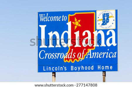 Blue sign against blue sky welcomes you to Indiana - stock photo